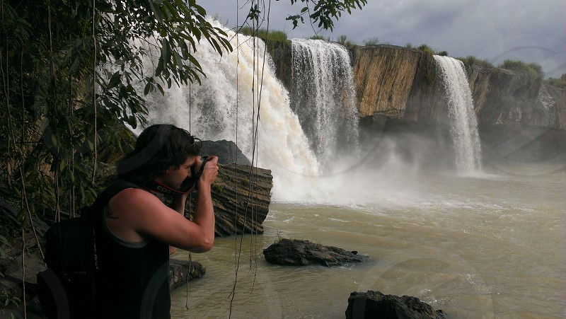 Taking pictures of a waterfall. Vietnam. photo