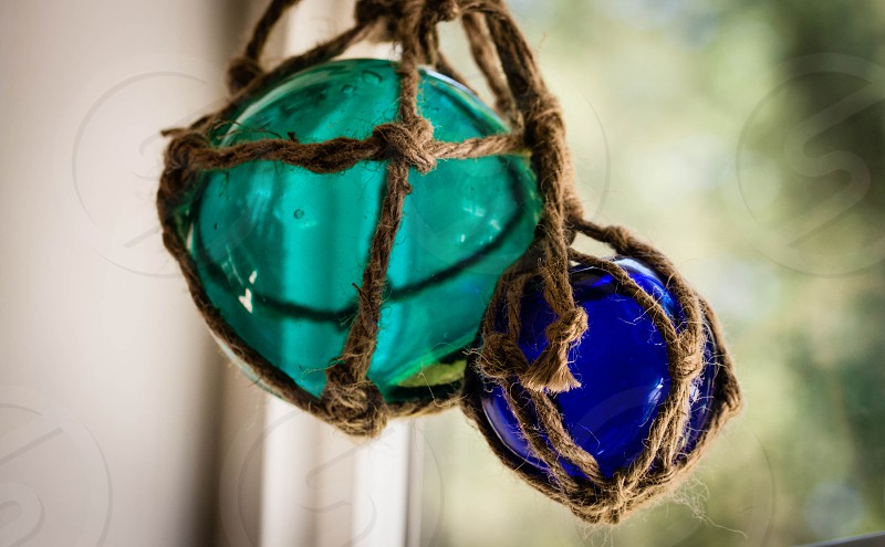 blue glass balls in rope net photo