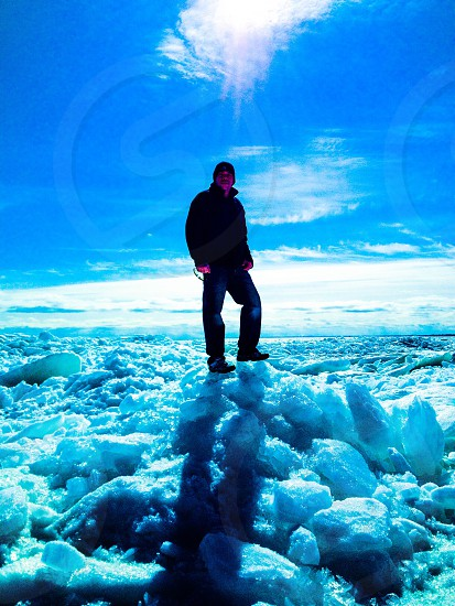 man standing on ice wearing black jacket and beanie fashion photography photo