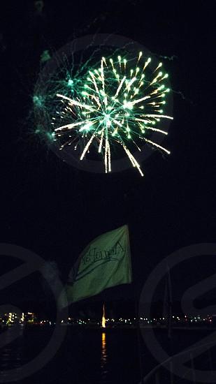 Green fireworks over flag photo