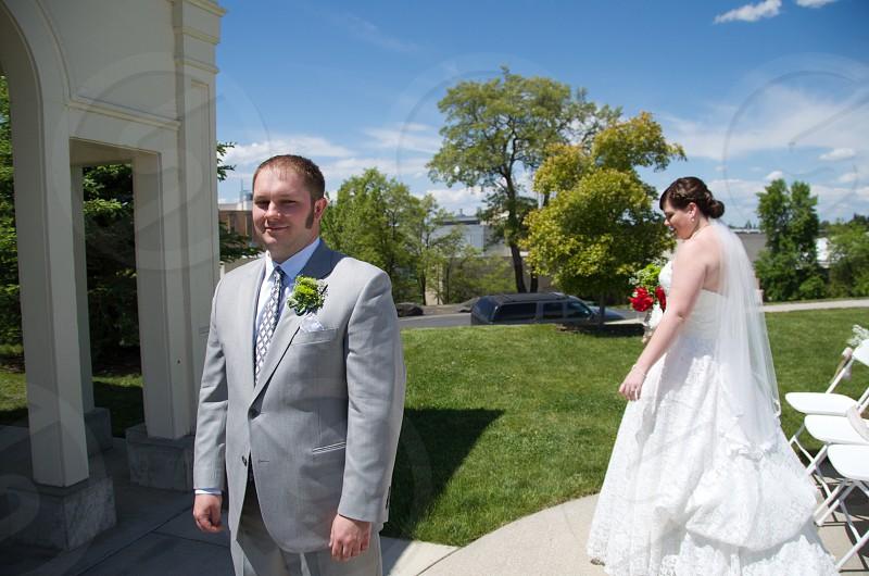 Wedding outdoors groom bride surprise first look photo
