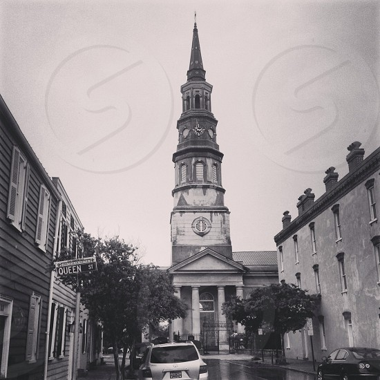 white column building with steeple tower photo