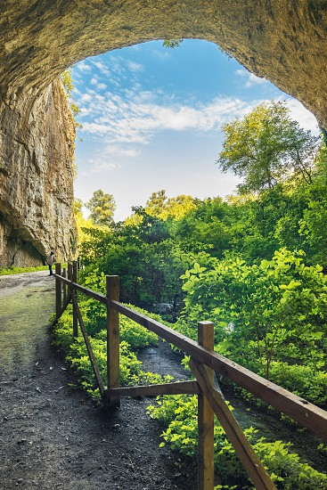 Panoramic view inside the Devetashka Cave near Devetaki village and Osam river in Bulgaria photo