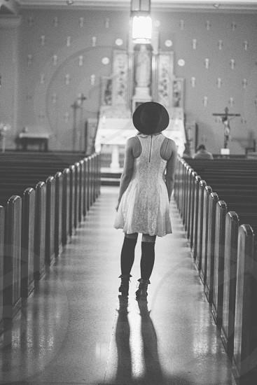 woman waling towards the church altar photo