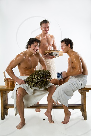Three young athletic men after the Russian bath photo