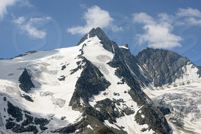 Peak of Grossglocker mountain with snow in summer time. Austria. photo