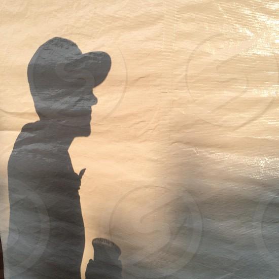 Shadow of a man in a baseball cap  photo