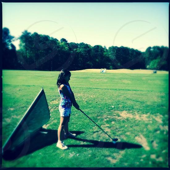 Little girl golfer photo