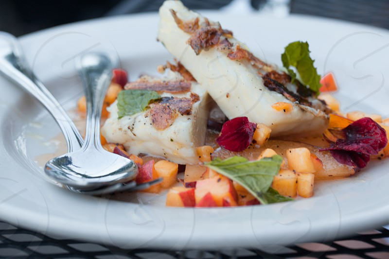 A plate of stone fruits and haloumi cheese bring fresh flavors to Spring. photo