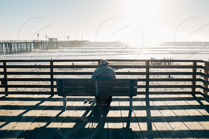 person sitting on bench photo
