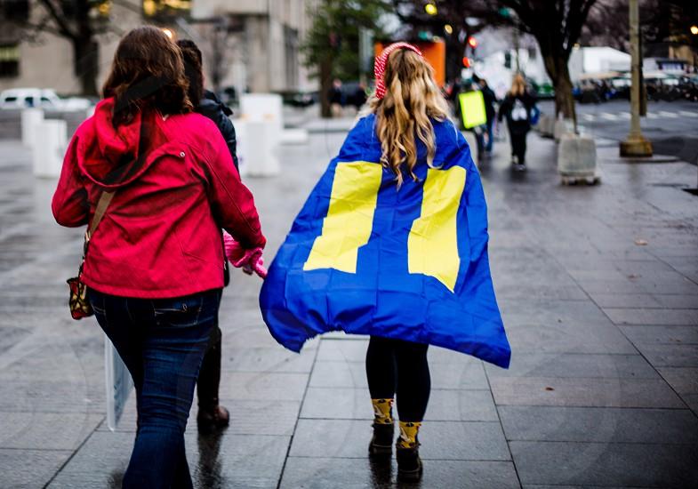 LGBTQ flag worn as a cape. photo