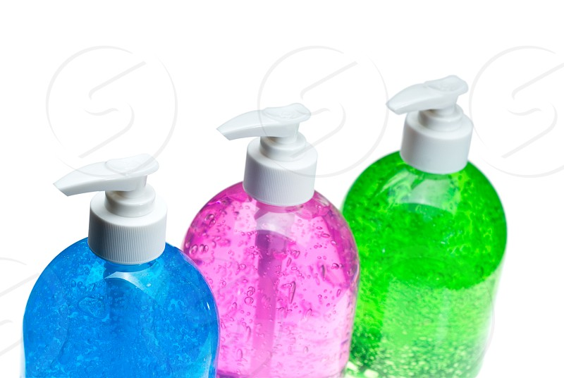 colorfull bluepink and green hair gel bottles over white background photo
