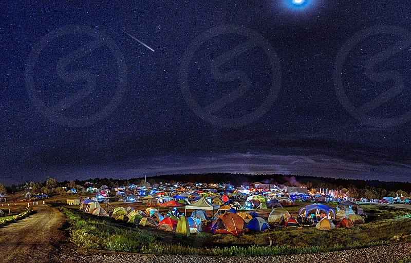 assorted tents on green grass field photo