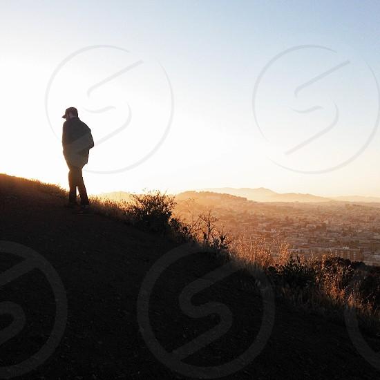 man climbing mountain photo