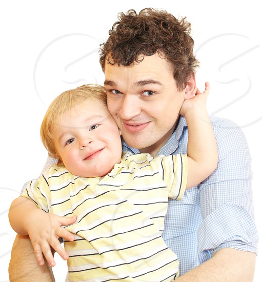 Young father with his son are smiling into the camera. photo