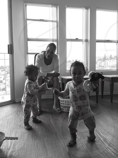 grayscale photograph of two toddlers with woman wearing white scoop-neck 3/4-sleeved photo