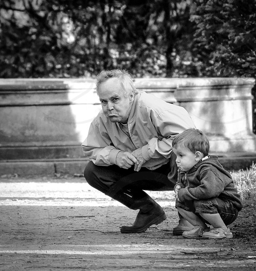 Grandad copying sulking grandson photo