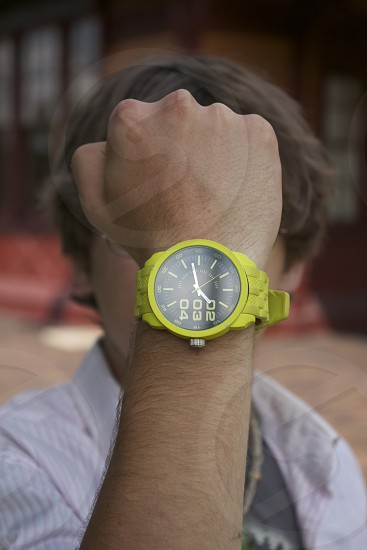 9:00 time on neon green wrist watch photo