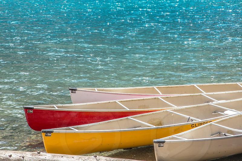 Canoes on Moraine Lake photo