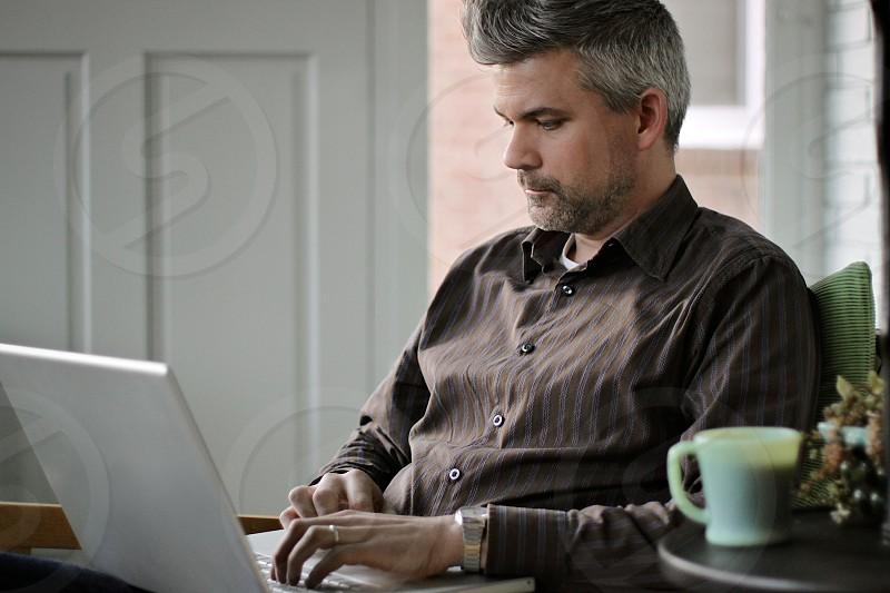 Man laptop computer search home mug grey photo
