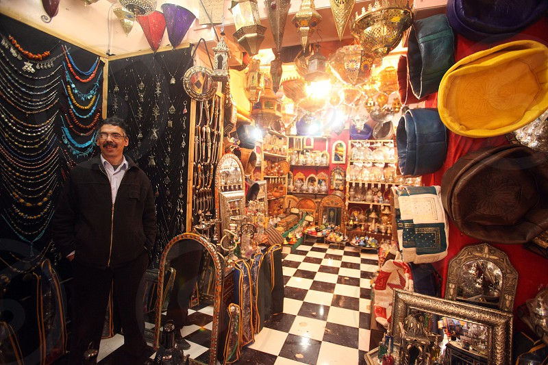 a shop in the Marketroad in the Medina of old City in the historical Town of Fes in Morocco in north Africa. photo