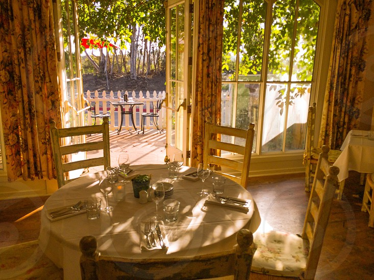 brown wooden dining set near a window  photo