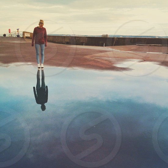 Girls reflection in a puddle  photo