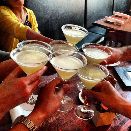group of people holding cocktail glass photo