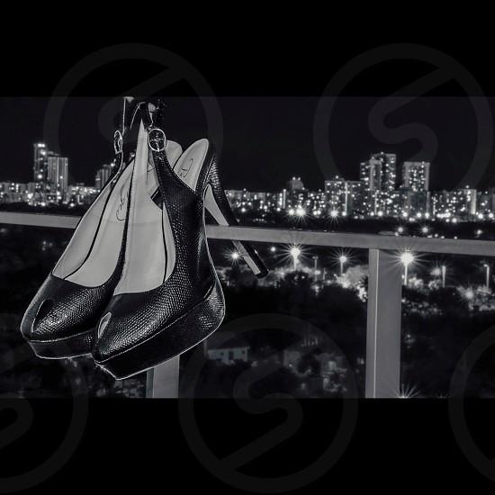 black leather ankle strap high heeled platform shoes photo