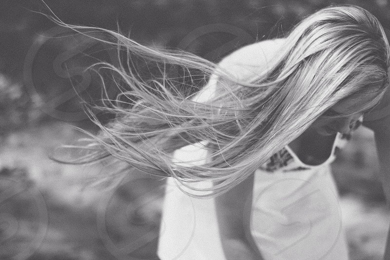 black and white photo of a woman with long blonde hair photo