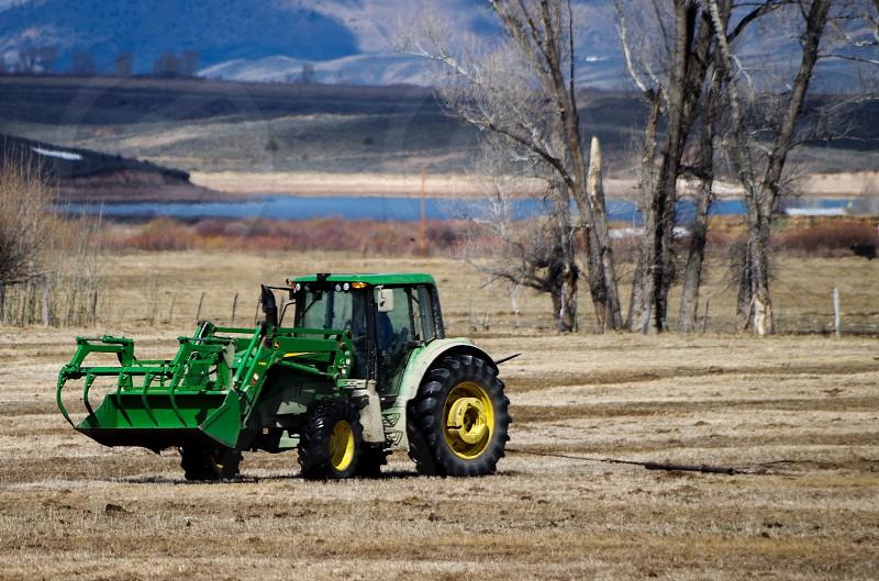 Tractor on the farm Colorado Rockies photo