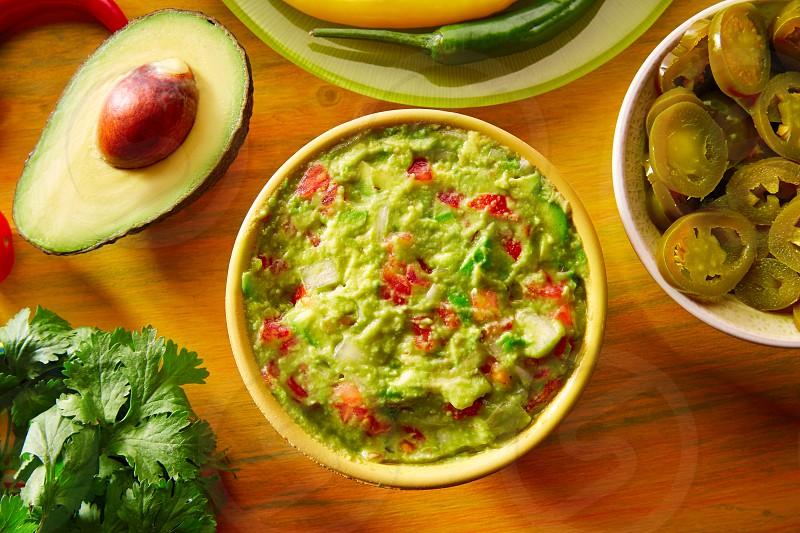 Mexican food mixed guacamole nachos chili sauce dipping cheddar cheese lemon pico de gallo photo