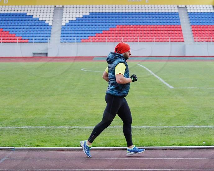 Running on stadium  photo