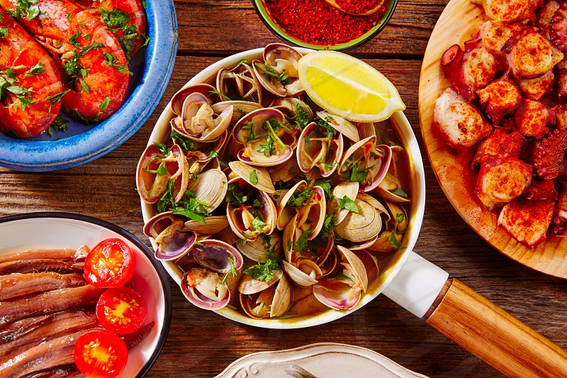Tapas seafood clams shrimps anchovies shrimps octopus pulpo from Spain photo