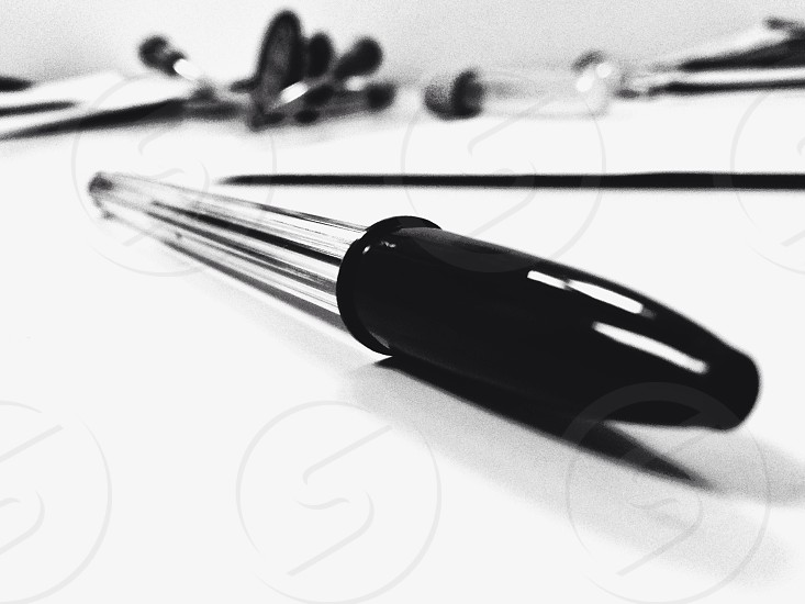 My main tools when I was working at the hospital a new pen and my stethoscope in the background. photo
