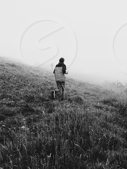 human running on grass field photo