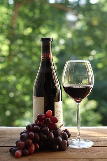 wine bottle glasstwo grape rustic wood photo