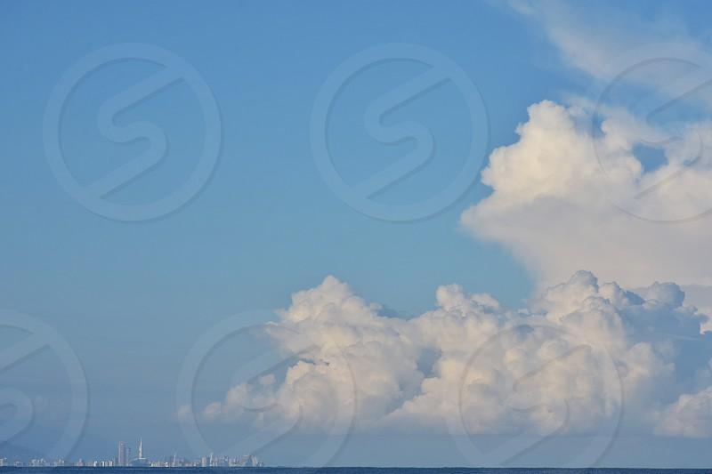 white cumulus clouds in blue sky photo