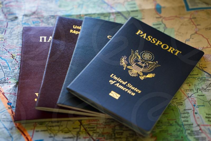 An arrangement of international passports laying on a map. photo