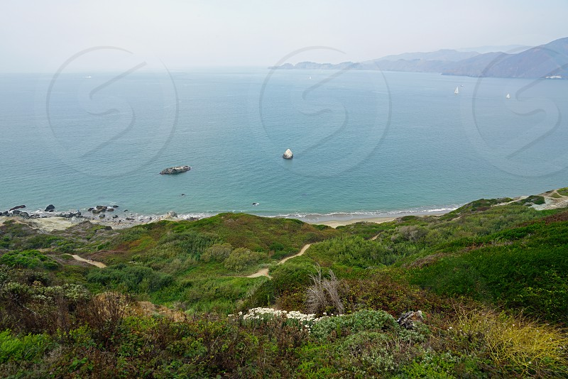 View of Baker Beach at the bottom of the Golden Gate bridge in San Francisco photo