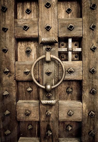 Large oversized castle doors with ornate hardware. photo