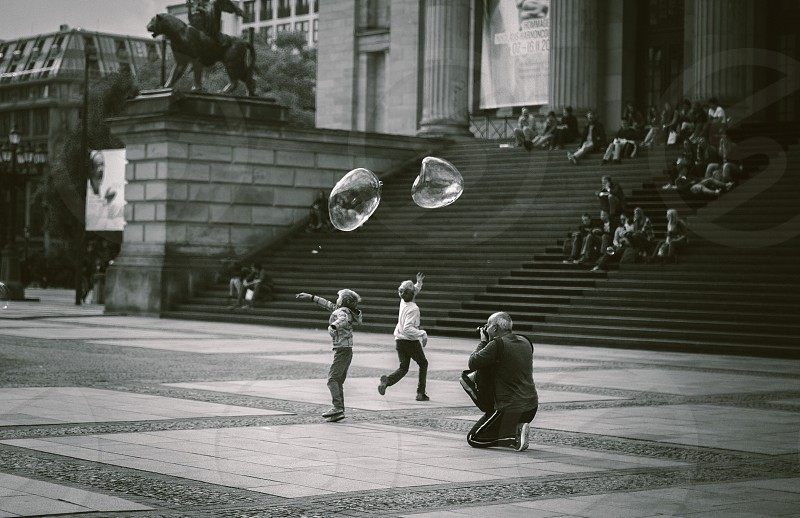 Children playing with giant bubbles in Berlin. photo