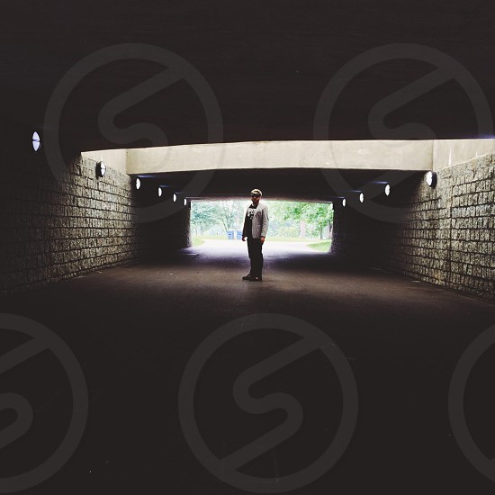 man standing in tunnel photo