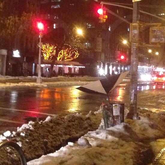 A broken umbrella in winter on the city street photo