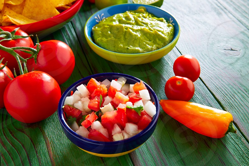 Mexican food nachos guacamole pico de gallo and chili peppers sauces photo