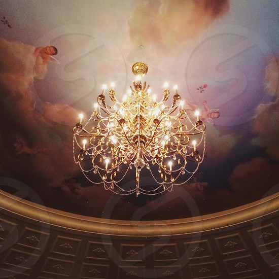 ceiling light chandelier gold and white with sky and cloud painting mural ceiling photo