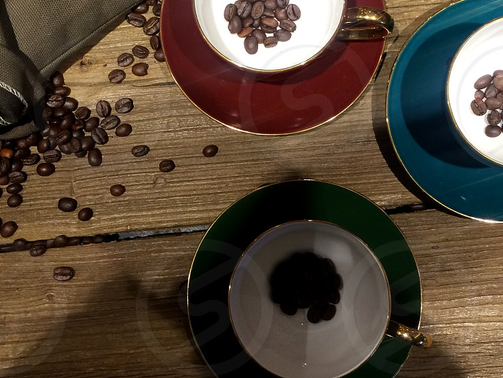 coffee beans on bags over rustic wood background photo