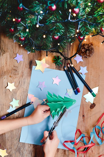 Making Christmas tree decoration from paper photo