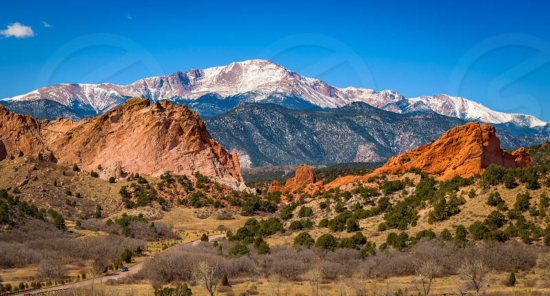 landscape photography of brown green and white mountain during daytime photo