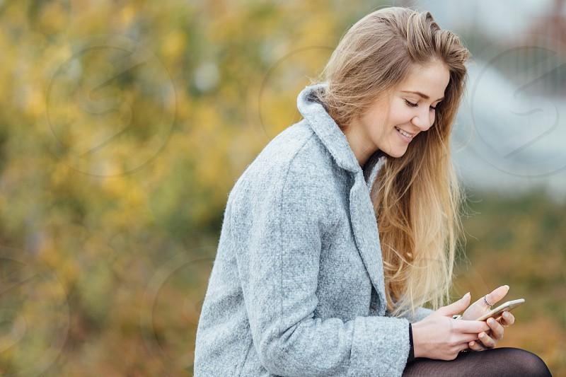 Woman watching at phone photo